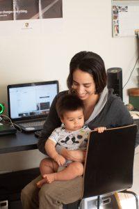 Mom balances work-life with baby.